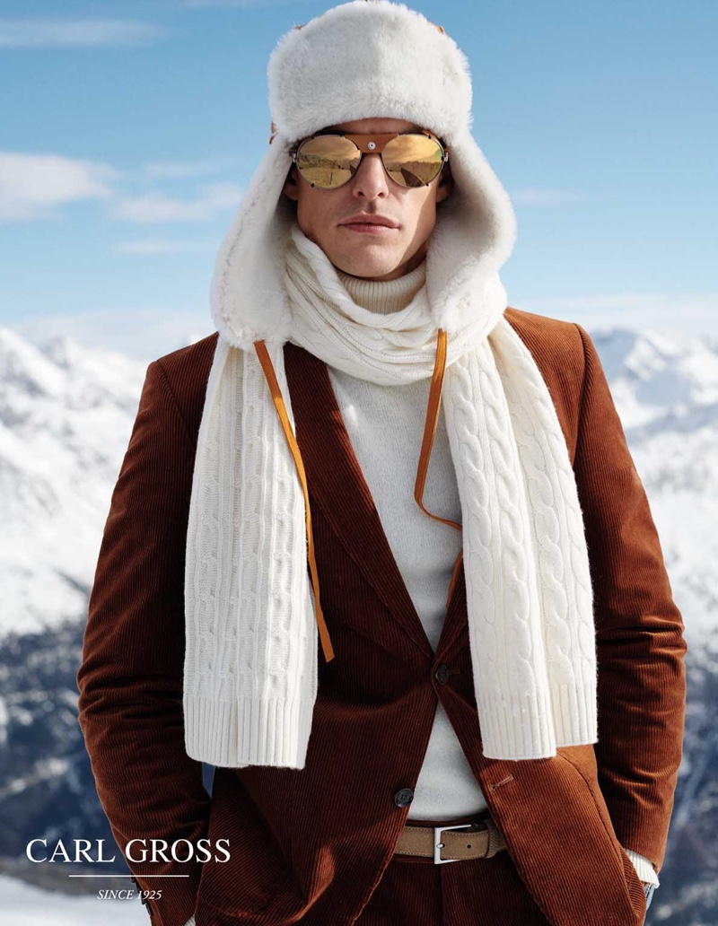 Filip Wolfe styles a sharp Carl Gross look with a trapper hat and cable-knit scarf.