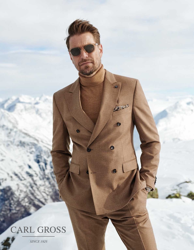 Dressed to impress, Bertil Espegren models a double-breasted suit with a turtleneck sweater from Carl Gross.