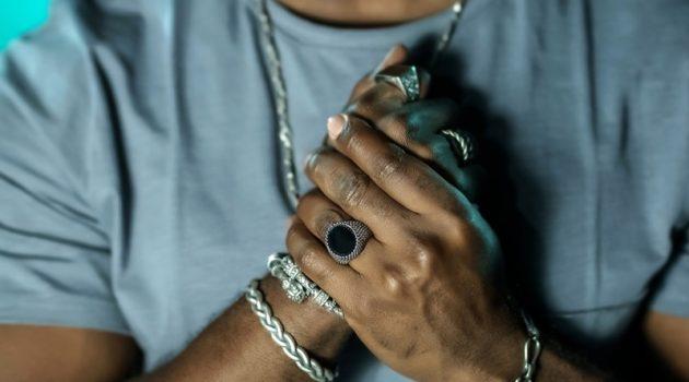 Closeup Men's Hands Jewelry Rings Bracelets
