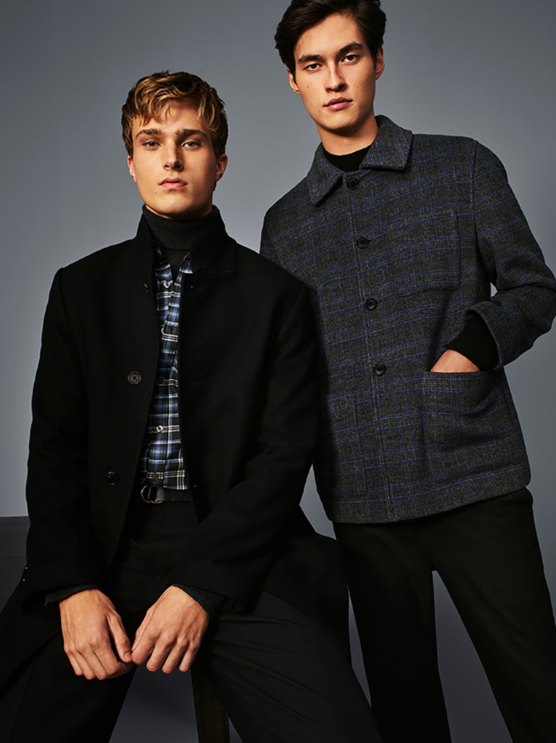 Donning dark hues, Cypress Hayunga and Douglas Dillon front Club Monaco's holiday 2020 campaign.