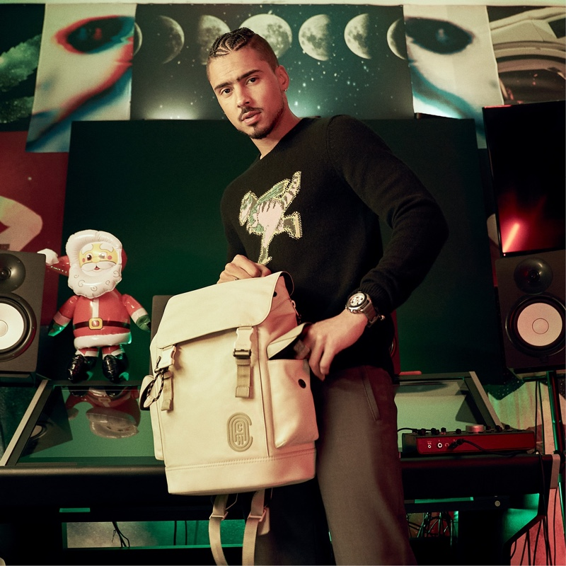 Quincy poses with Coach's Rivington backpack for the brand's holiday 2020 campaign.