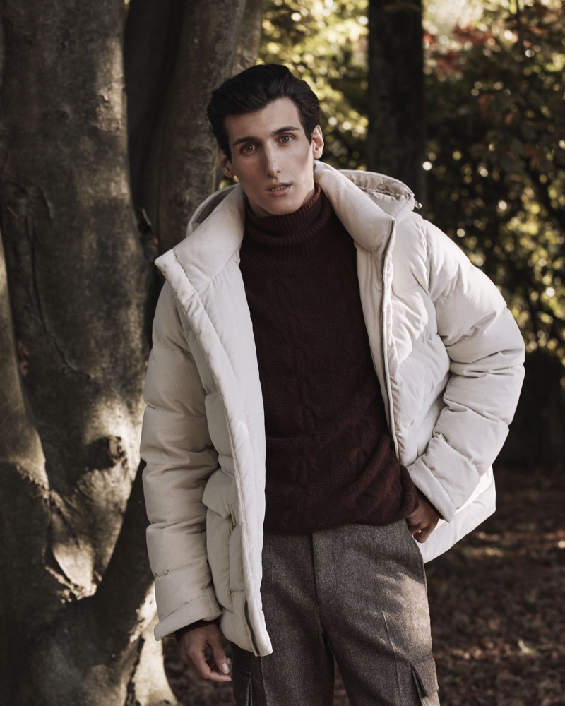Sporting a down coat, Leo Mel appears in Corneliani's fall-winter 2020 campaign.