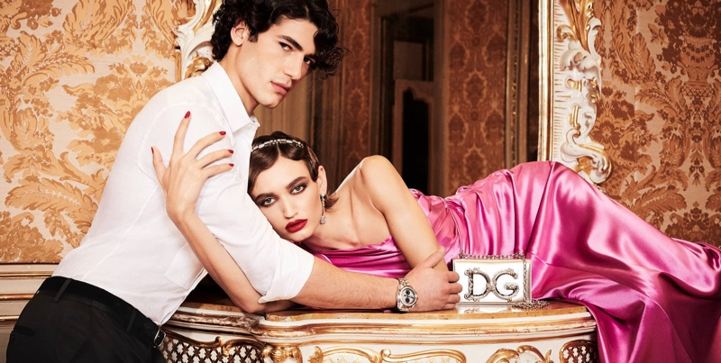 Models Davide Lenoci and Beatrice Brusco charm in exquisite holiday attire from Italian fashion house Dolce & Gabbana.