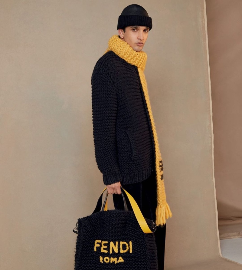 Making a case for warm knitwear, Noah Sapon sports a cozy look from Fendi's fall-winter 2020 collection.