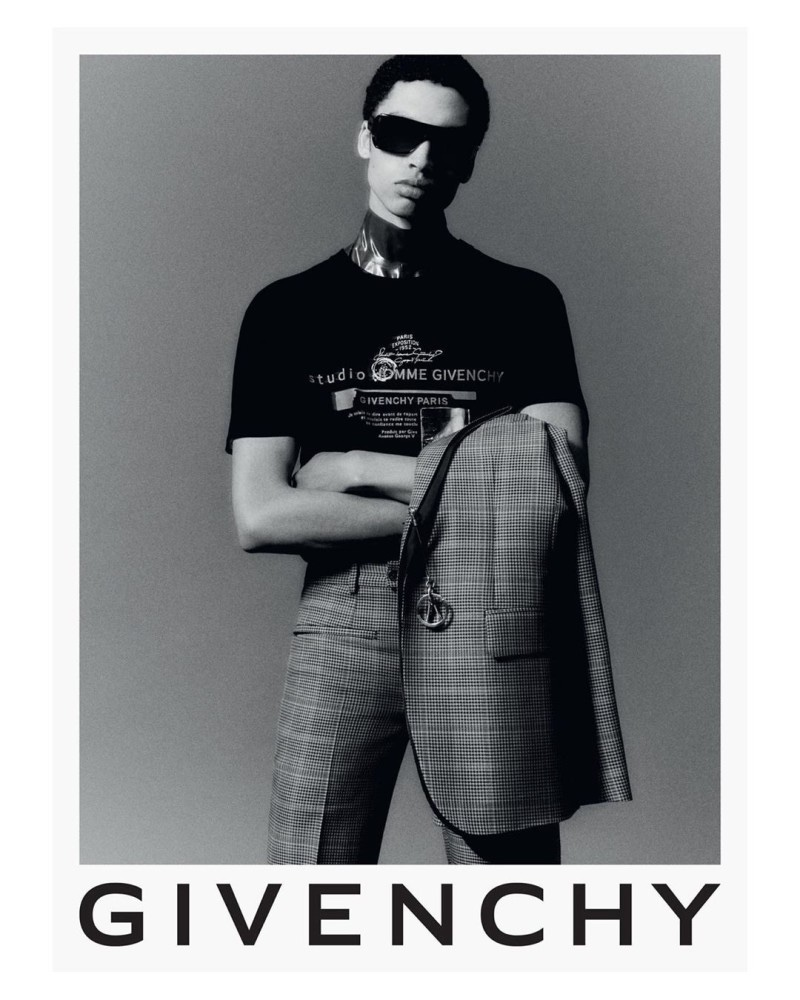 Sol Goss dons a suit with a logo tee for Givenchy's fall-winter 2020 campaign.