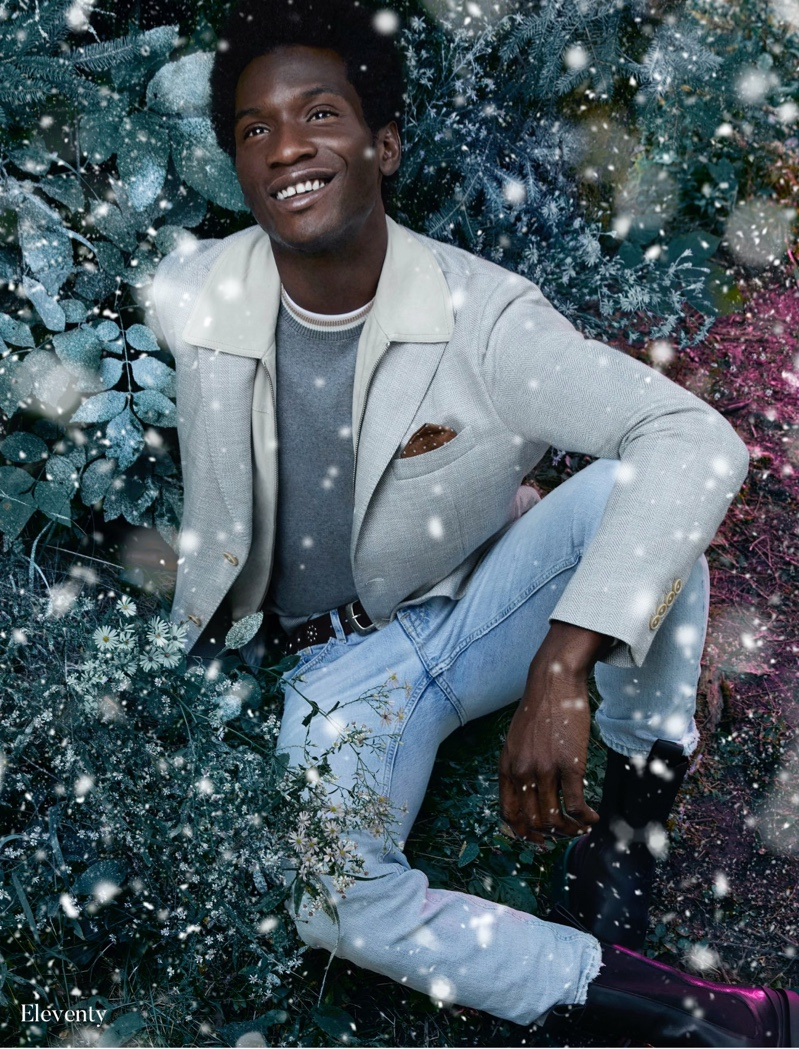 Reuniting with Holt Renfrew for the holidays, Adonis Bosso models a contemporary look from Eleventy.