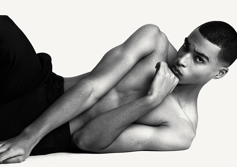 Wearing Sandro pants, Jerome appears in a black and white images photographed by Dennis Weber.
