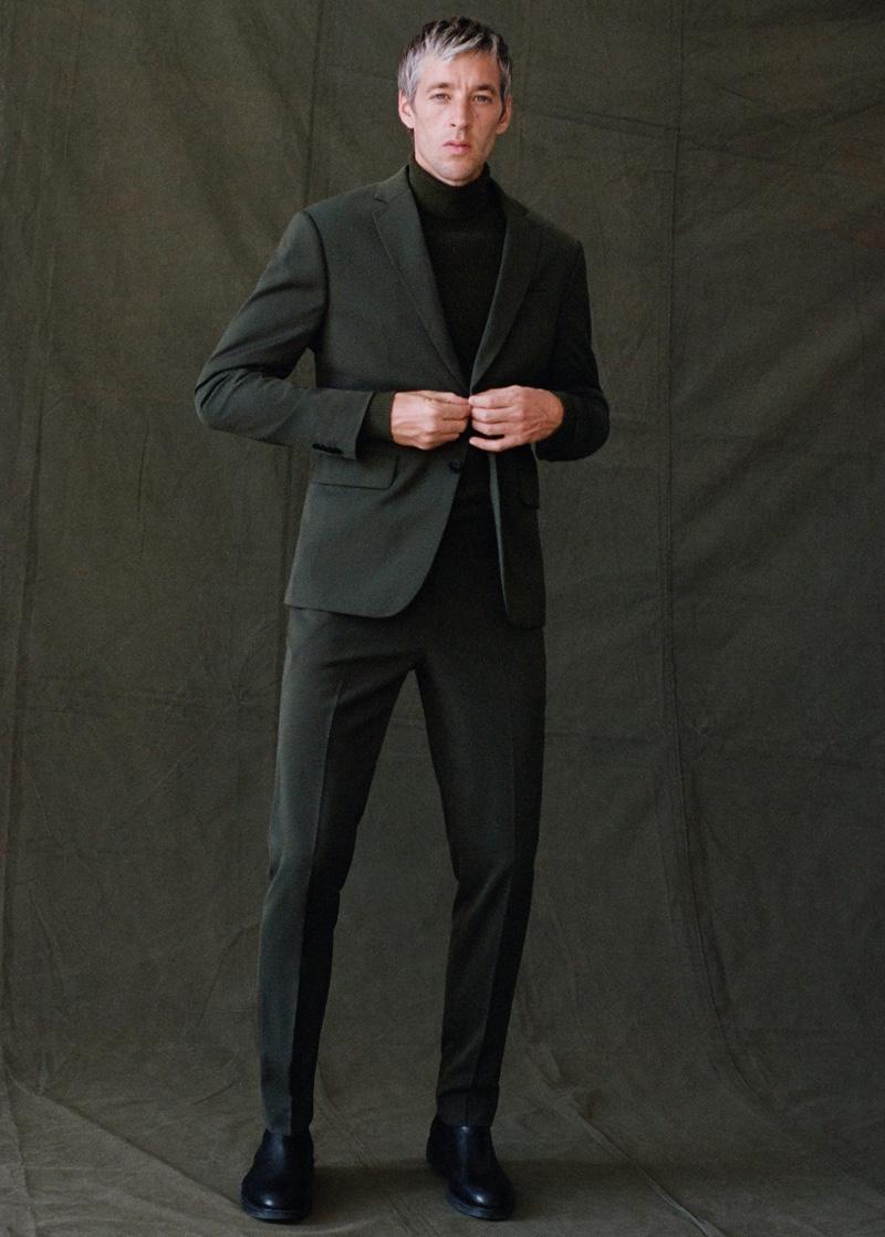Donning a slim-fit suit, Joel Frampton wears Mango Man.
