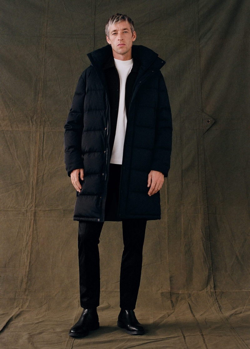 British model Joel Frampton wears a black puffer jacket with a cotton t-shirt by Mango.