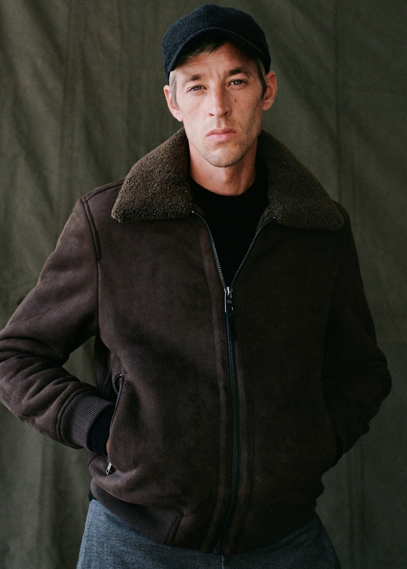 Front and center, Joel Frampton sports Mango's wool-blend baseball cap with a bomber jacket and trousers.