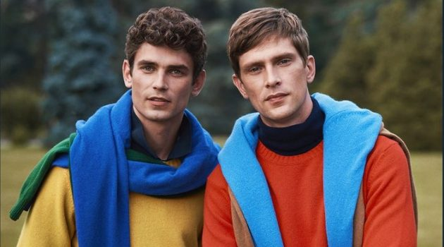 Models Arthur Gosse and Mathias Lauridsen don colorful sweaters for OVS PIOMBO's fall-winter 2020 campaign.
