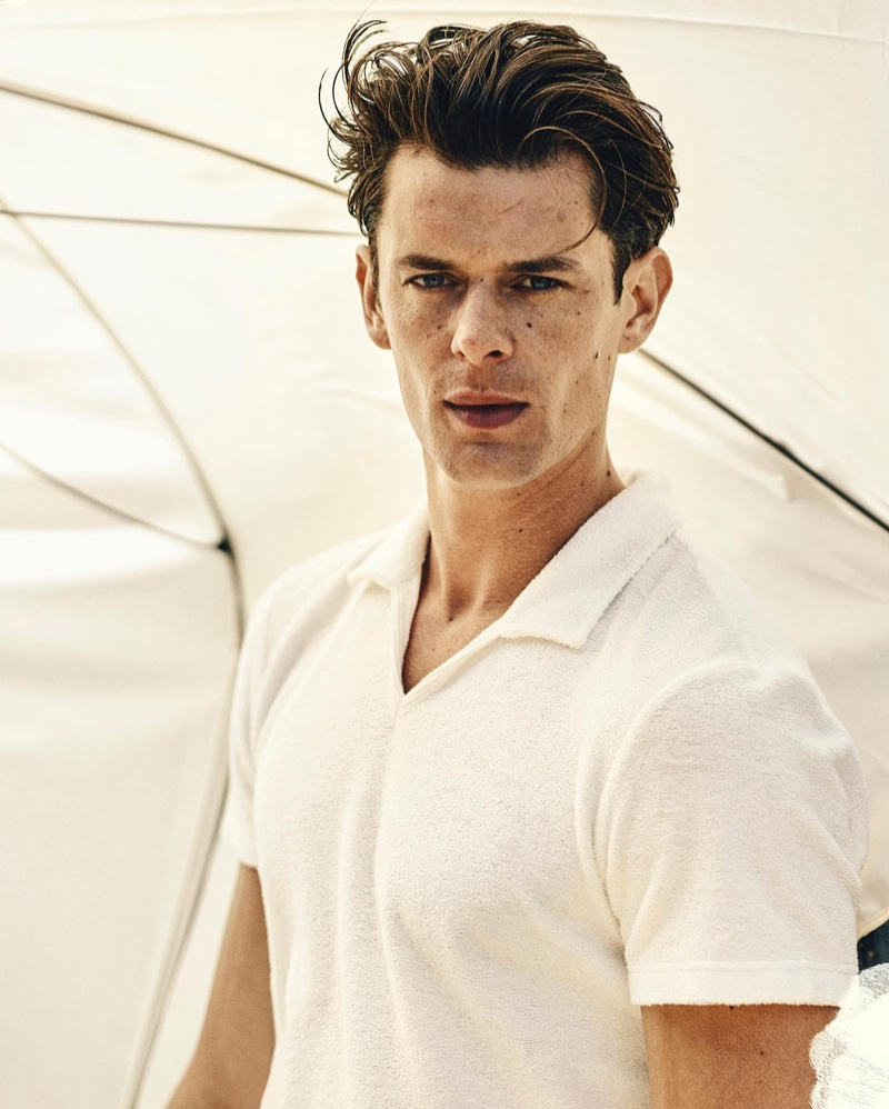 Lewis Jamison sports Orlebar Brown's Marden Towelling white tailored fit polo shirt.