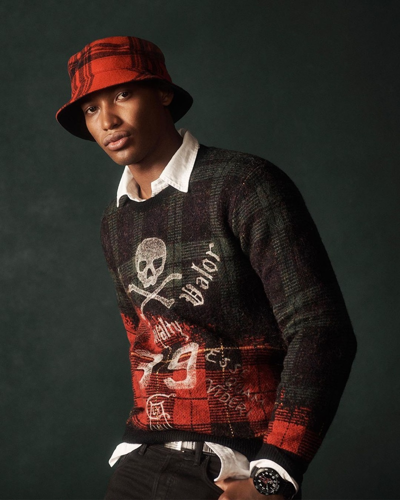 Timothy Lewis sports a rebellious take on the tartan sweater from POLO Ralph Lauren's holiday 2020 collection.