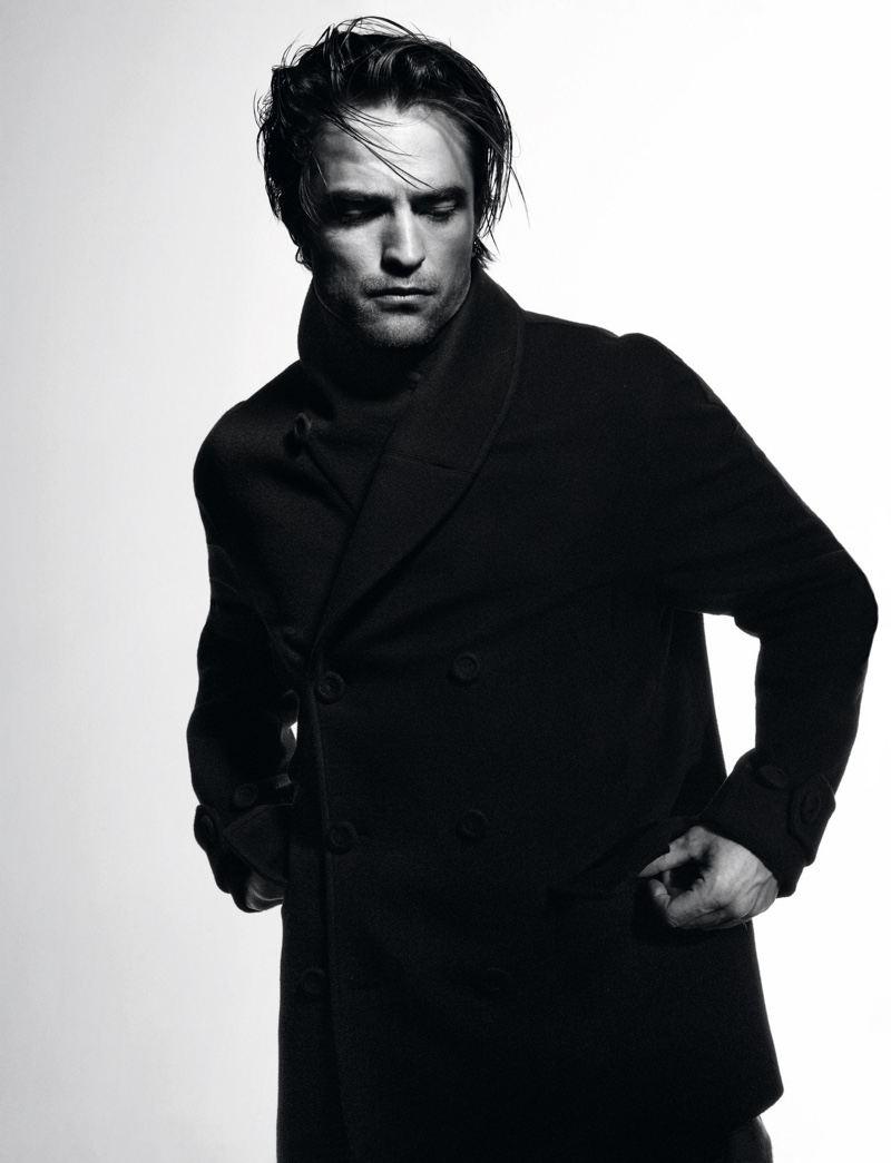 Robert Pattinson dons a double-breasted coat for Dior magazine.