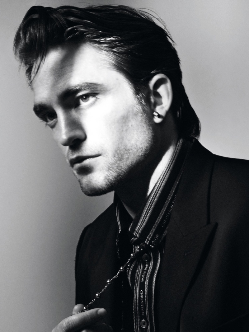 Delivering a side profile, Robert Pattinson appears in a black and white photograph for Dior magazine.
