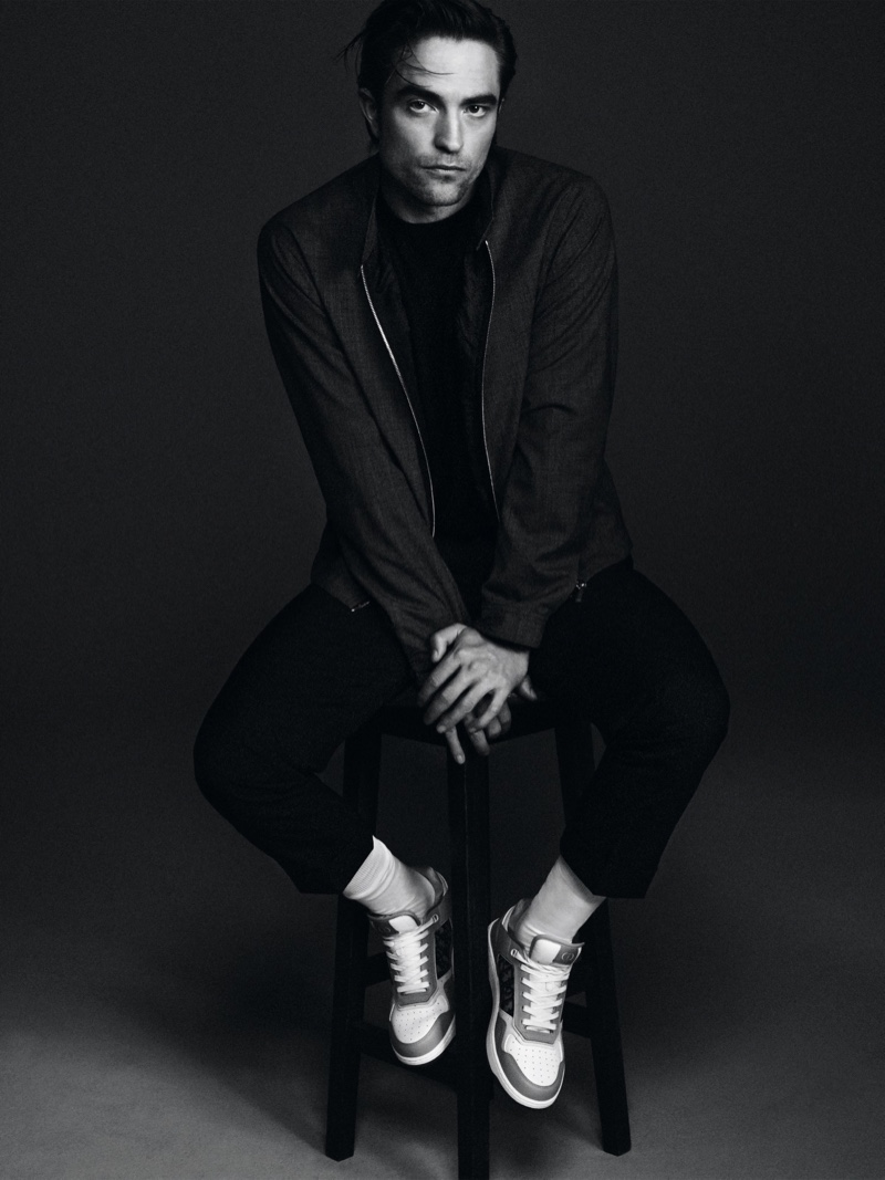 Sitting for a portrait, Robert Pattinson wears a spring-summer 2021 look from Dior Men.