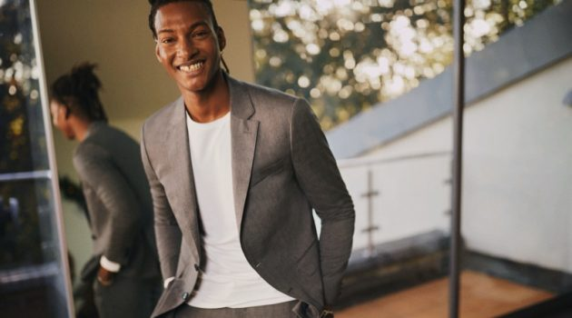 All smiles, Ty Ogunkoya suits up for Tommy Hilfiger's holiday 2020 campaign.