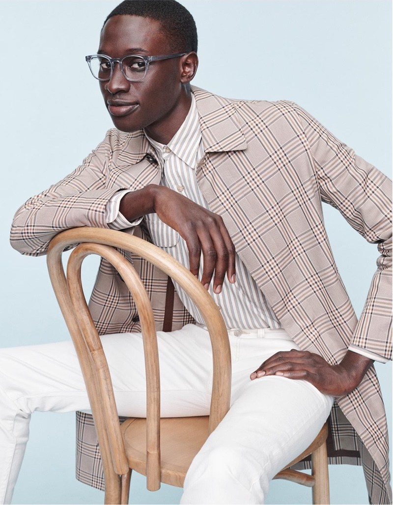 Baba Diop wears Warby Parker's Felix glasses with a low bridge fit in pacific crystal.