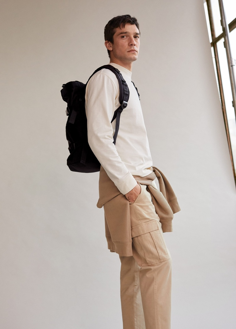 Alexis Petit models a casual look from Mango that includes a long-sleeve pullover and cargo pants.