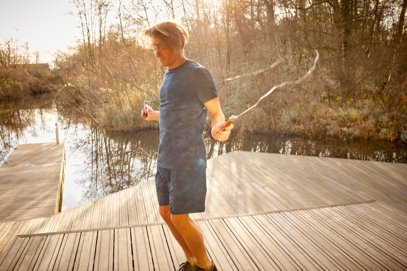 Jumping rope, Oliver Cheshire rocks a tie-dye t-shirt and jersey shorts from Derek Rose.