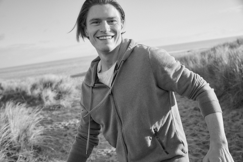 Going casual, Oliver Cheshire wears a men's hoodie by Derek Rose.