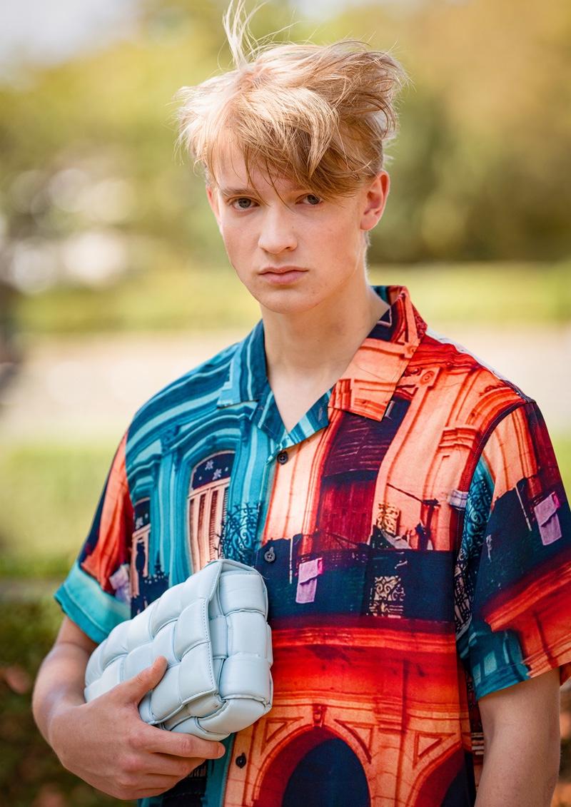 Fynn wears shirt Huf and bag Bottega Veneta.