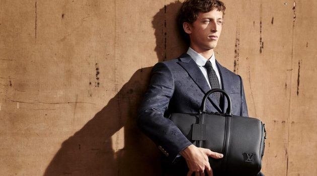 Alexis Maçon-Dauxerre takes hold of a leather bag from Louis Vuitton's new LV Aerogram collection.