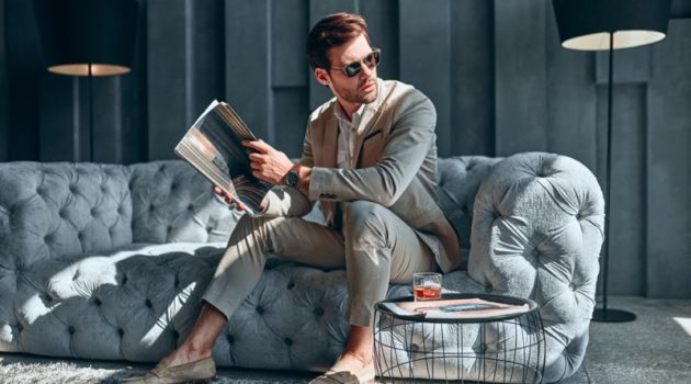 Male Model Tan Suit Grey Couch Elegant Home Decor Magazine