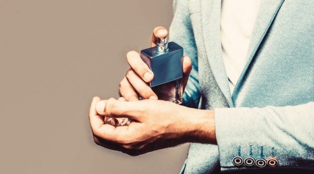 Male Spraying Cologne Wrists