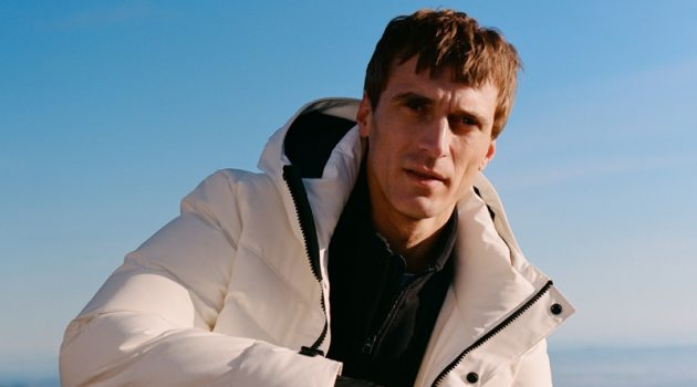 Clément Chabernaud sports puffer jacket with a half-zip pullover and pants from Mango Man's Improved collection.