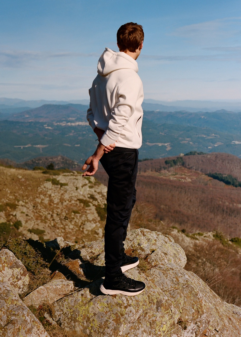 Embracing casual and sporty styles, Clément Chabernaud rocks a white hoodie from Mango Man's Improved collection.