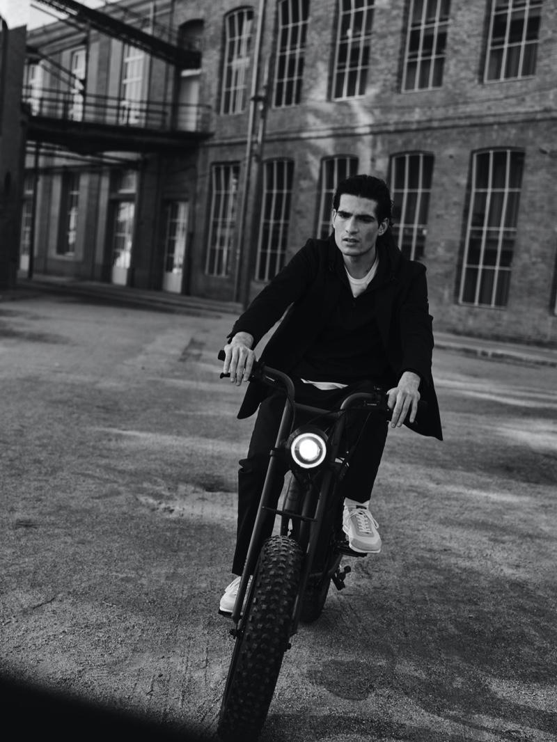 Showcasing the flexibility of Massimo Dutti's menswear, Philip Lach De Bere rides a bike.