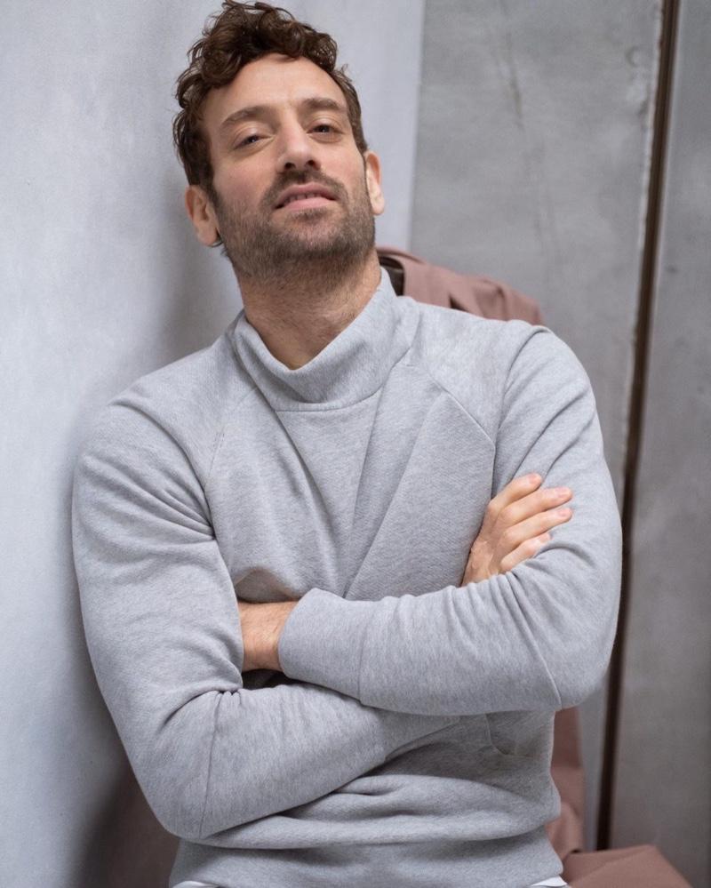 Going casual, Matthew Avedon wears a mock neck sweatshirt by Banana Republic.
