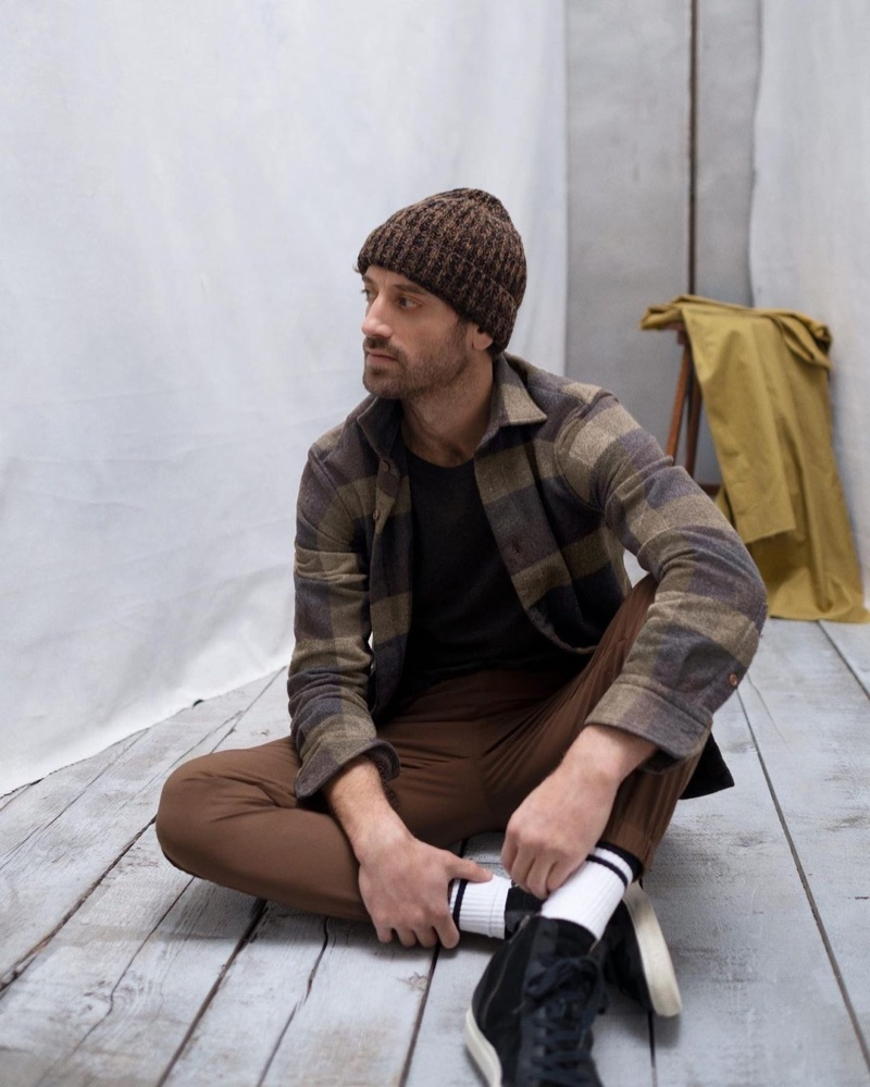 Front and center, Matthew Avedon sports a plaid shirt jacket with joggers from Banana Republic.