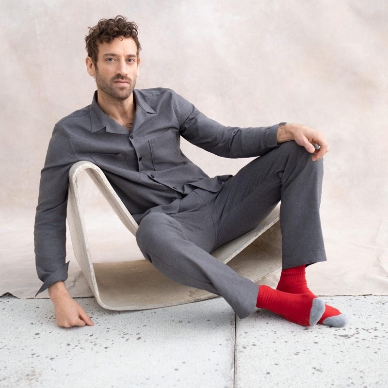Showcasing sleepwear, Matthew Avedon wears a matching pajama set from Banana Republic.