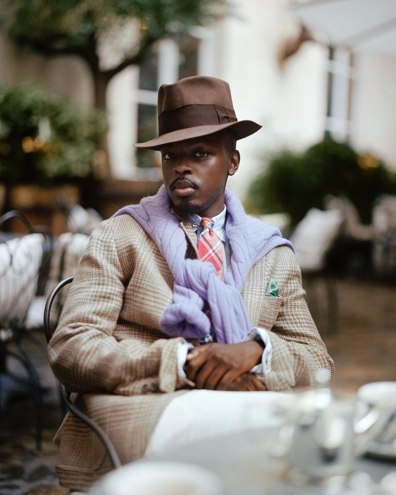 Showcasing a dandy appeal, Kevis Manzi wears a spring look from POLO Ralph Lauren's Heritage Icons collection.