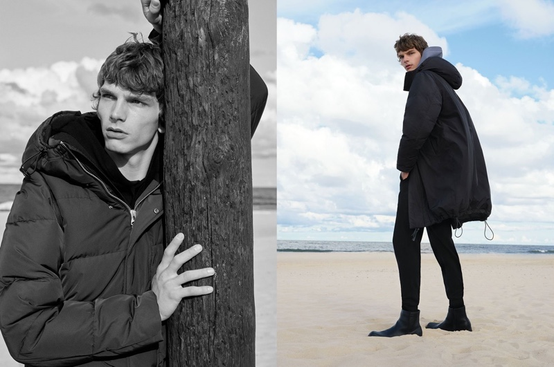 Hitting the beach, Erik Van Gils wears a down-filled jacket, waterproof down-filled coat, organic cotton hoodie, and merino wool jersey trousers from Reserved's Premium Sustainable collection.