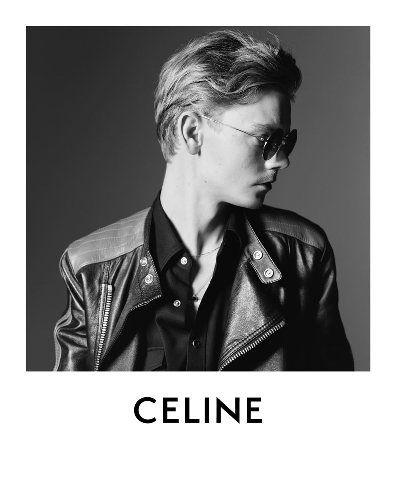 Delivering a side profile, Thomas Brodie-Sangster wears a motorcycle leather jacket for Celine's spring-summer 2021 campaign.