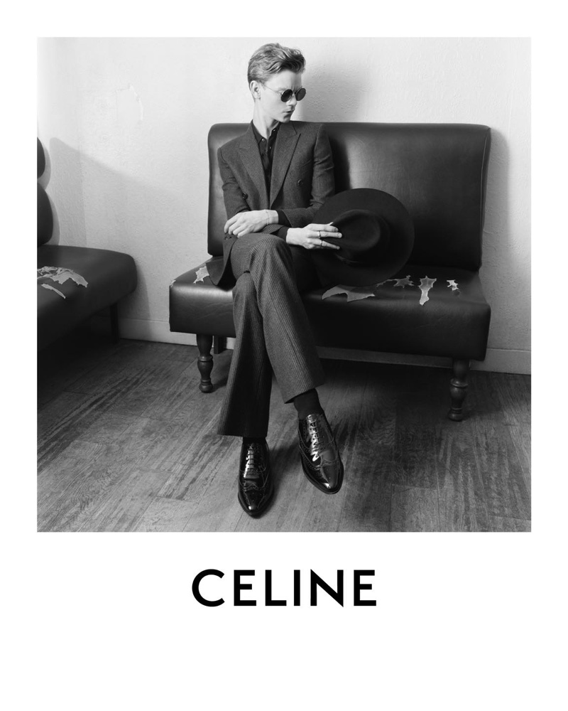 Thomas Brodie-Sangster dons a double-breasted suit for Celine's spring-summer 2021 campaign.