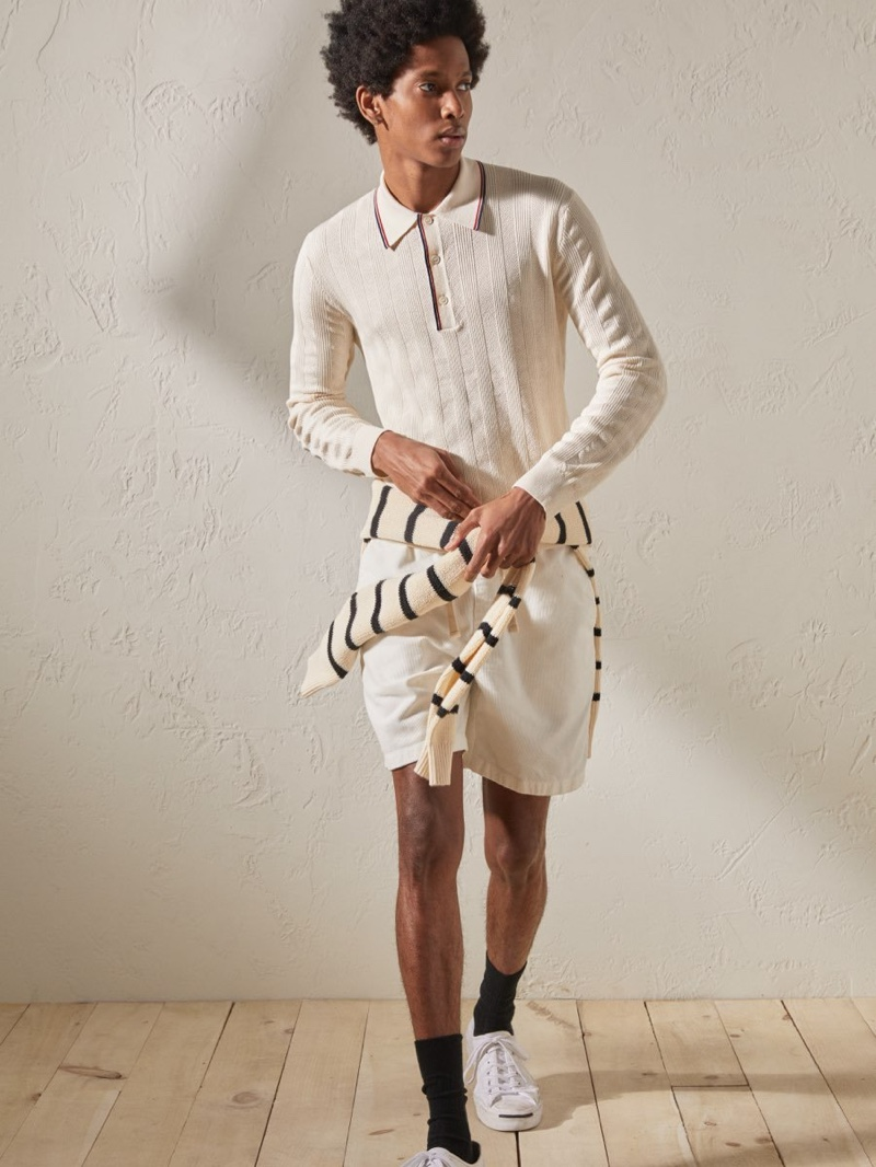Embracing early spring style, Rafael Mieses dons a Todd Snyder long-sleeve tipped sweater polo in ivory.