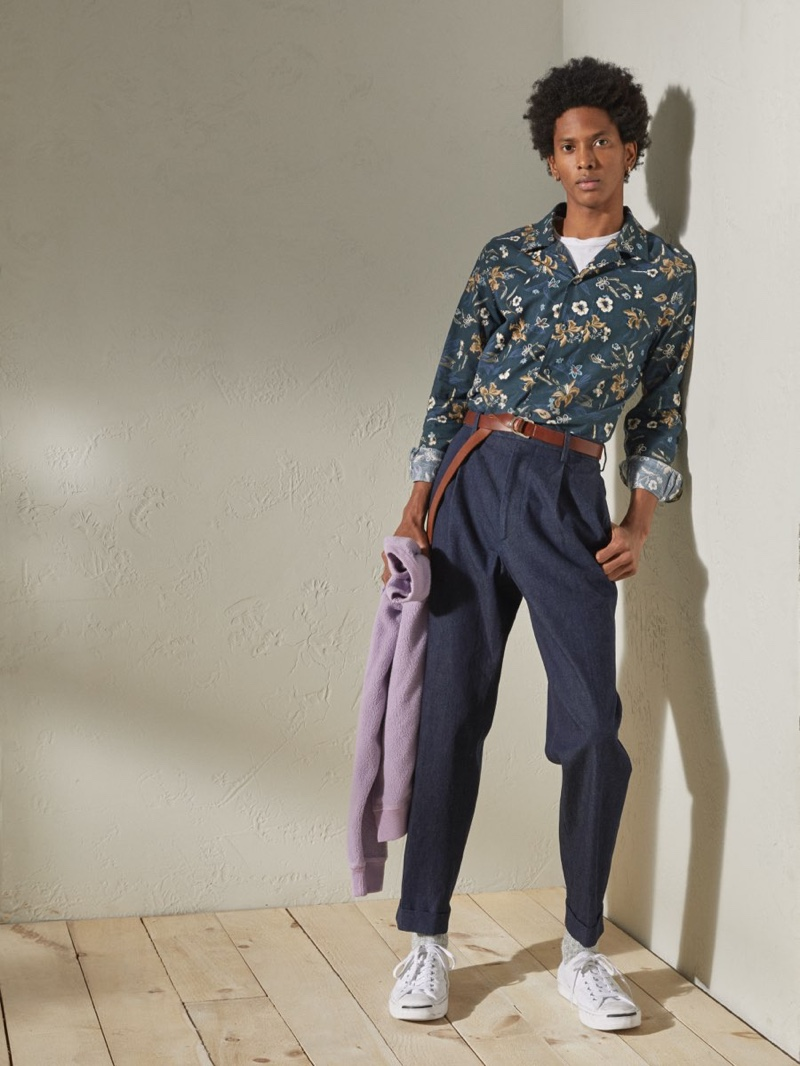 Channeling a resort cool, Rafael Mieses rocks a Todd Snyder Italian floral camp collar long-sleeve shirt in navy with Japanese denim pleated pants in indigo.