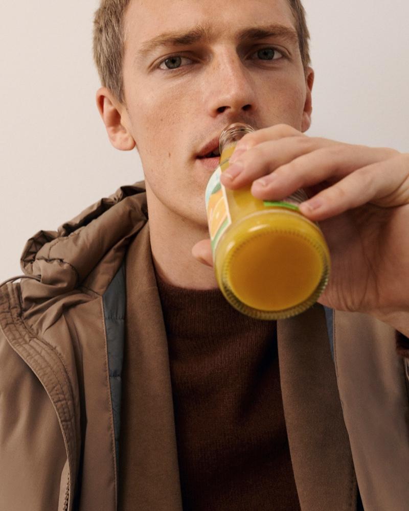 Drinking orange juice, Victor Nylander begins a stylish day with Massimo Dutti.