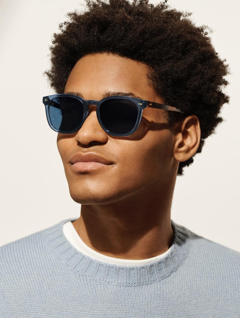 Toddy Warby Parker sunglasses in azure crystal with oak barrel.