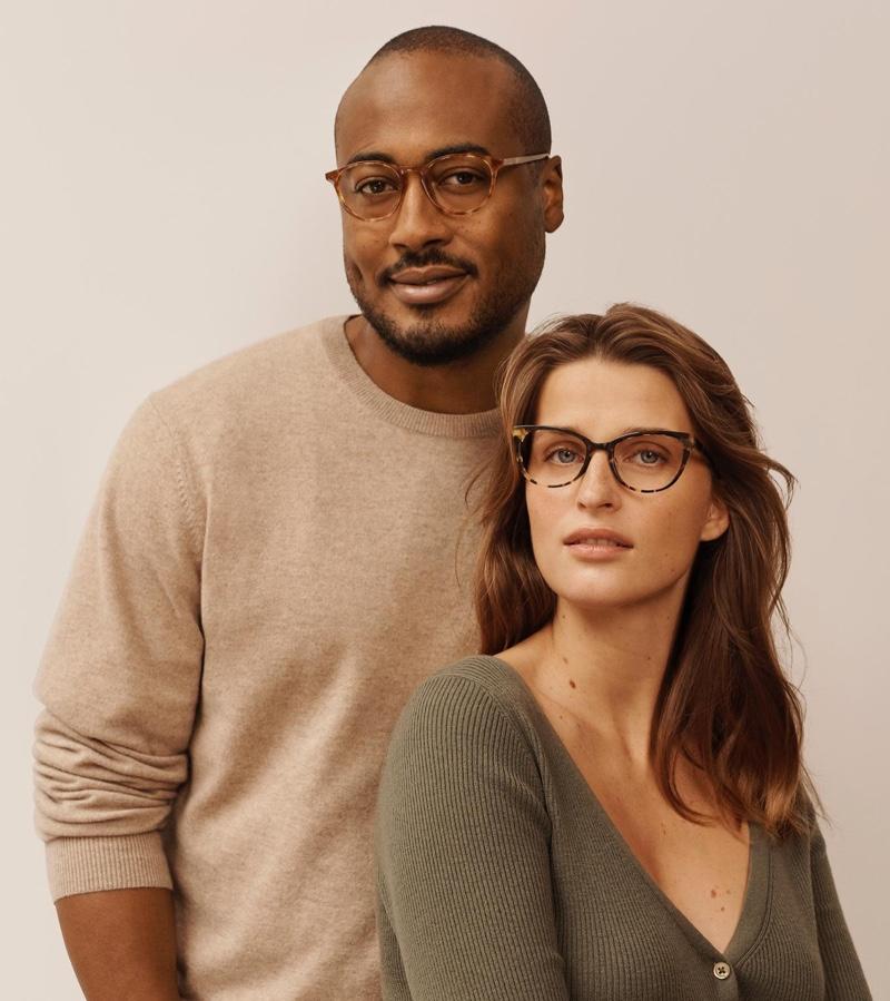 Butler Warby Parker glasses in butterscotch tortoise and Shea glasses in burnt lemon tortoise.