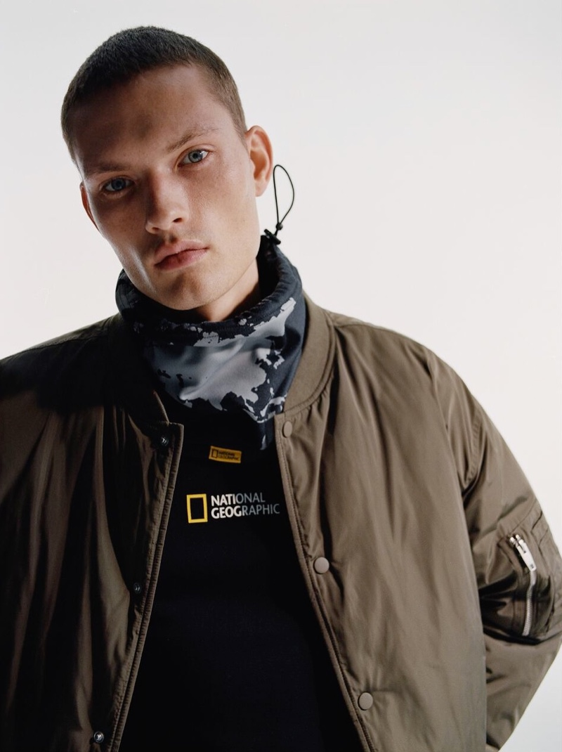 Rocking a bomber jacket, William Los also wears a National Geographic print sweatshirt from Zara.