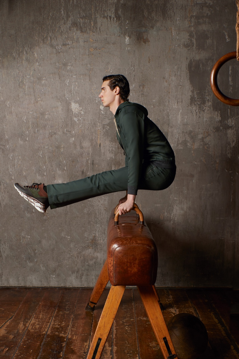 Pictured on a leather pommel horse, Marco Bozzato stars in ZILLI Sport's fall-winter 2020 campaign.