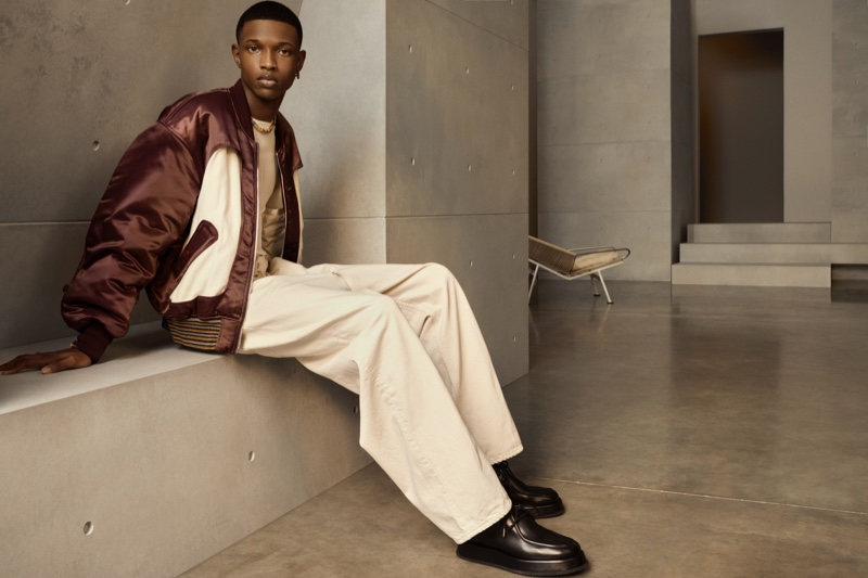 Sporting a bomber and relaxed-cut pants, Malik Anderson stars in AMBUSH's spring-summer 2021 men's campaign.