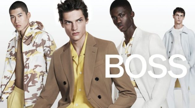 Models Yun Hoseok, Valentin Caron, Jeremiah Berko-Fourdjour, and Luc Defont-Saviard don yellow and neutral-toned looks for BOSS's spring-summer 2021 men's campaign.