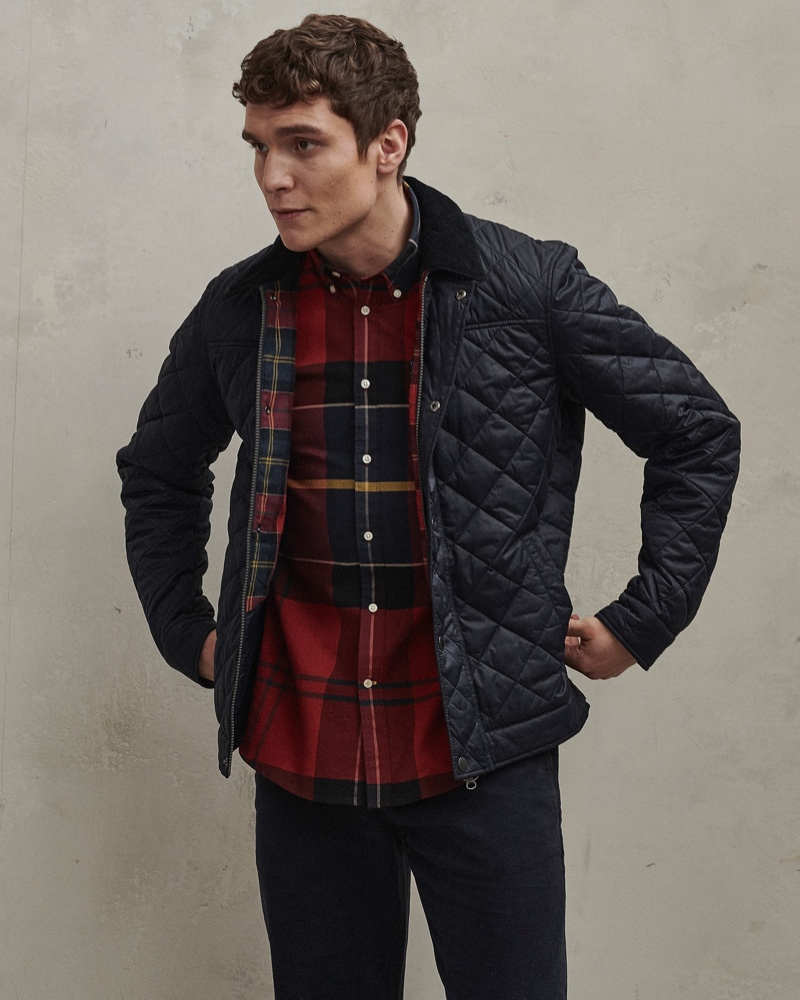 Front and center, George Admiraal wears a quilted jacket with a tailored shirt from Barbour's men's Tartan collection.
