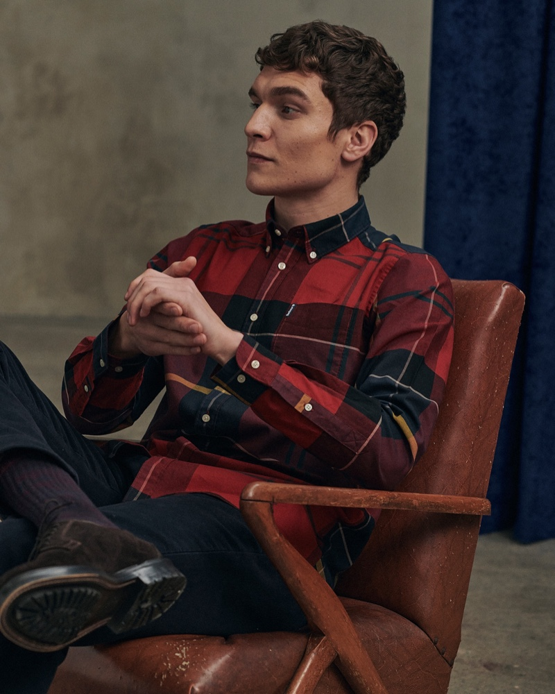 Relaxing, George Admiraal wears a red tailored shirt from Barbour's new Tartan collection.